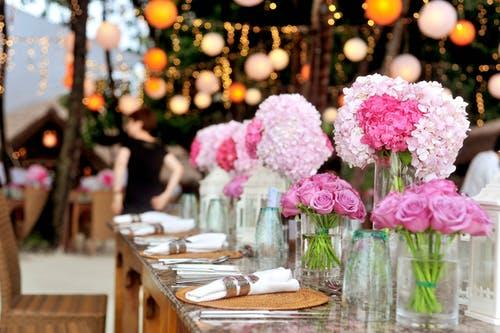Table With Plates and Flowers Filed Neatly Selective Focus Photography